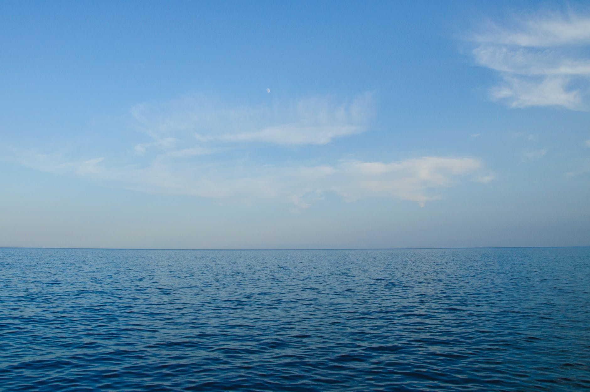 blue body of water under white clouds